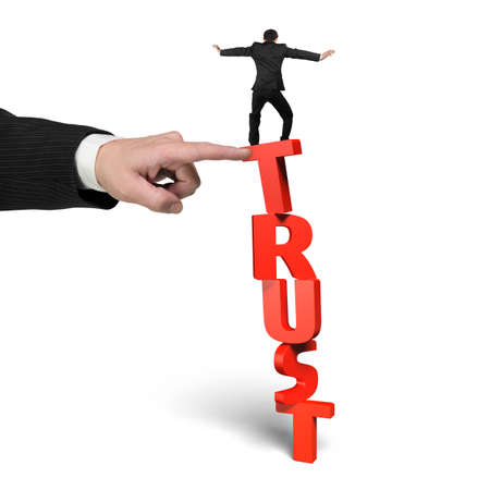 rely: One man stopping red vertical trust word, with another big mans hand helping, isolated on white.