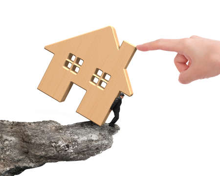 rent index: Man holding wooden house on cliff edge with another big hand pushing, isolated on white background.