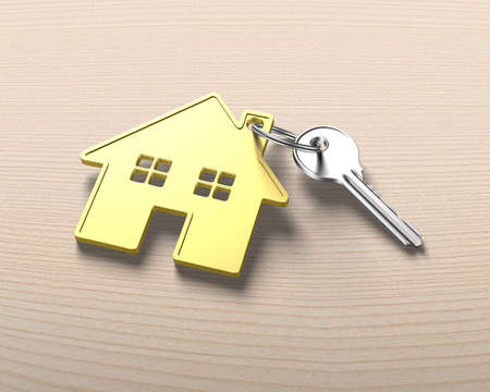 gold house: Silver key and gold house shape key ring, on wooden table background.