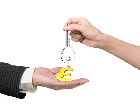 safekeeping: Woman hand giving silver key with gold pound symbol shape keyring to man hand, isolated on white background.