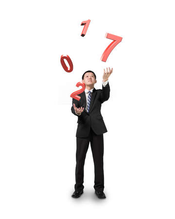 difficult task: Businessman catching throwing 2017 red words, isolated on white background. Stock Photo