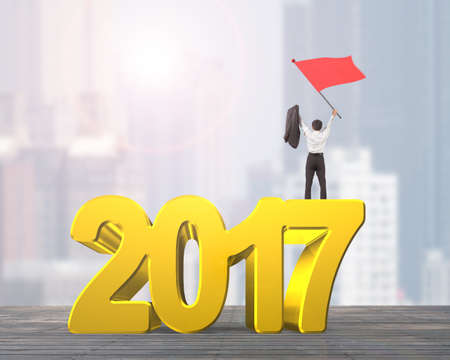 turns of the year: Man waving red flag standing on 2017 year, golden numbers, on city buildings background.