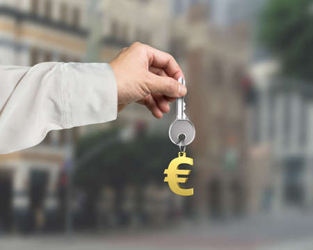 safekeeping: Man hand holding silver key with golden euro sign shape keyring, on city buildings background, 3D rendering