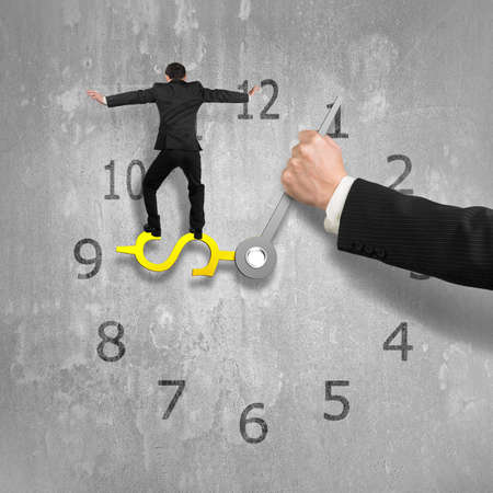 impede: Man balancing on USD sign clock hand with another holding, concrete wall background, 3D illustration