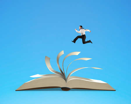 flipping: Businessman running on flipping pages top of open book isolated in blue background, 3D rendering