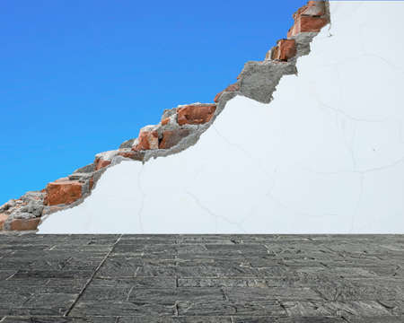 undermine: marble slab floor with crack white bricks wall and blue sky, background