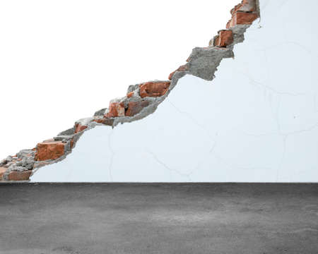 undermine: Crack bricks wall with white painting and dirty concrete floor Stock Photo