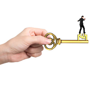 Man balance on treasure key in pound sign shape with hand holding, isolated on white background.