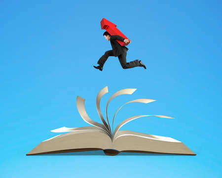 Businessman man carrying red arrow sign running on top of flipping pages of open book isolated on blue background.