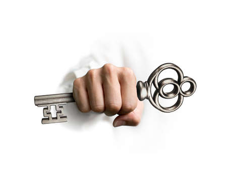 Hand holding the treasure key, isolated on white background, 3D rendering. Stock Photo