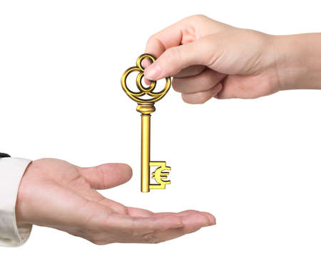 safekeeping: Woman hand giving Euro treasure key in dollar sign shape to man hand, isolated on white background. Stock Photo