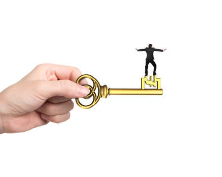 Rear view of man balance on treasure key in pound sign shape with hand holding, isolated on white background.
