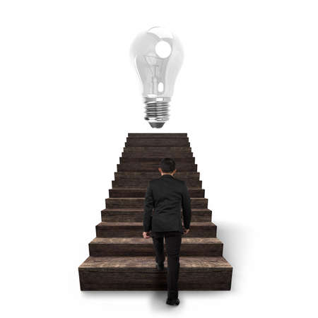 toward: Bulb on top of old wooden stairs with businessman climbing, isolated on white background.
