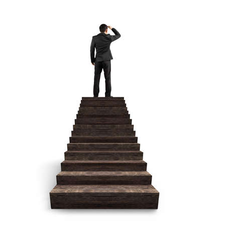 gazing: Businessman gazing on top of wooden stairs, isolated on white background.