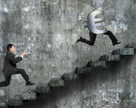 dirty old man: Man running after Euro money symbol with human legs, on old dirty concrete stairs with wall background.
