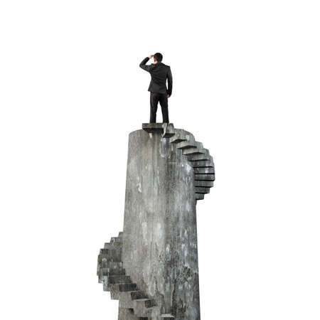 gazing: Businessman gazing on top of concrete spiral tower, isolated on white background.