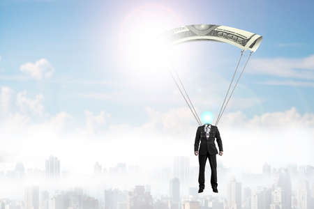 Man with money parachute flying in the sky. Outside manager concepts.
