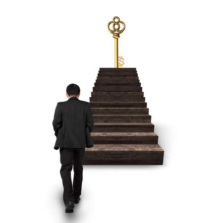 Man walking toward golden dollar sign treasure key on top of wooden stairs, isolated on white background. Stock Photo