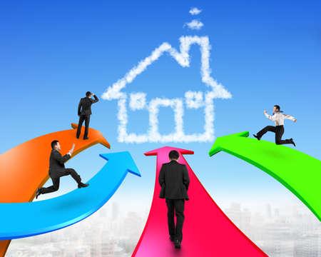 toward: Men on four color arrows go toward house shape cloud in the sky. Stock Photo