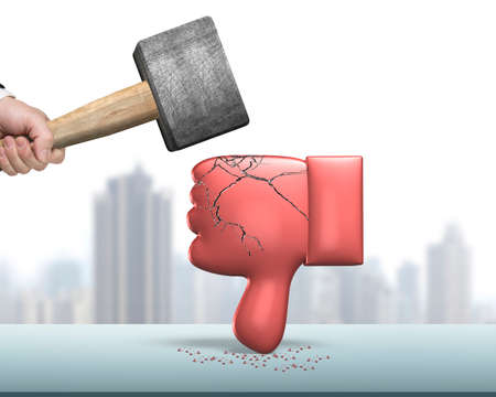 Hand holding hammer hitting red 3D thumb down with cracks