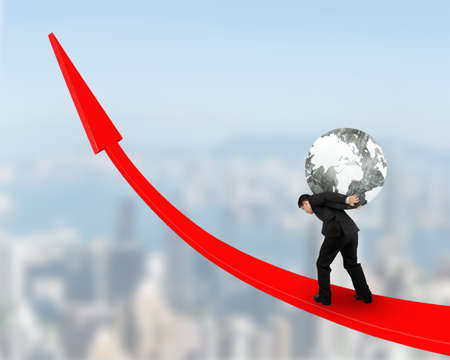 businessman carrying a globe: Businessman carrying black white globe upward on red trend line.