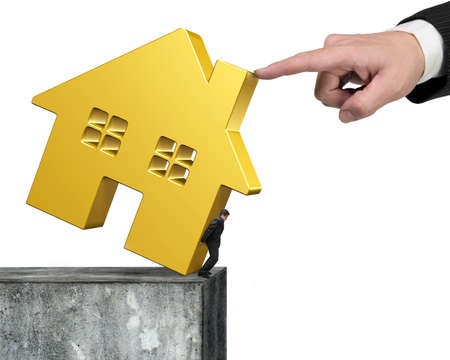 rent index: Man holding golden house at edge of high concrete wall with another big hand helping to stop falling, isolated on white background.