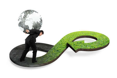 economic cycle: Green circular economy concept. Man carrying globe on arrow infinity symbol with grass texture.