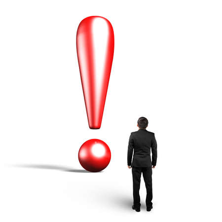 3D exclamation point with man looking up, isolated on gray background. Stock Photo