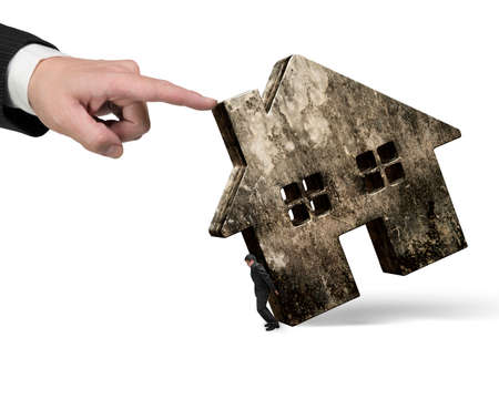 Man holding old dirty concrete house with another big hand pushing, isolated on white background.