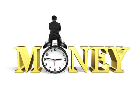 Man sitting on alarm clock with gold money word, isolated on white background.