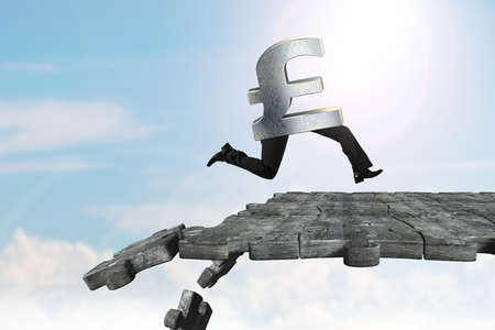 uk money: Pound symbol with human legs running on concrete puzzle ground with some pieces falling. Stock Photo