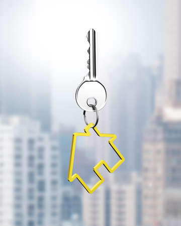 private access: Silver key with house shape keyring, on city buildings background. Stock Photo
