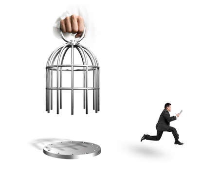 Hand opening the cage with man using tablet and running, isolated on white background. Stock Photo