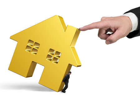 rent index: Man holding golden house with another big hand pushing, isolated on white background. Stock Photo