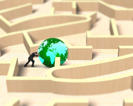 Man pushing green globe in the wooden maze game. Stock Photo