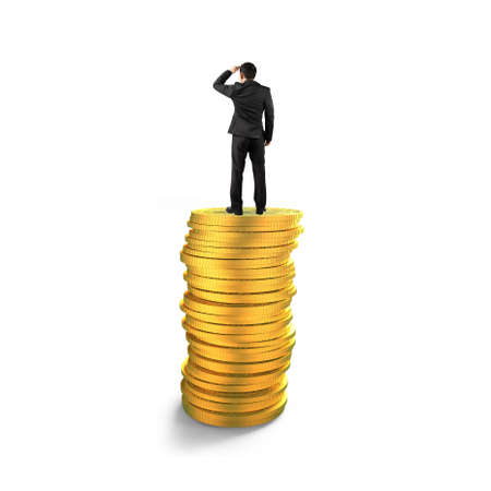 Rear view of businessman standing on top of golden coins stack and looking far into the distance, isolated on white background, concept of business financial growth success.