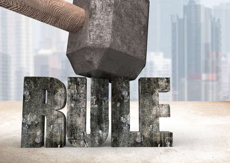 Sledgehammer hitting RULE 3d concrete word on table with cityscape background. Concept of breaking convention and impossible, change and innovation. Stock Photo