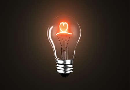Lighting bulb lamp with red heart shape on black dark background, 3D rendering, macro view