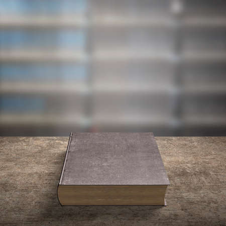 one old book on wooden desk with blur bookshelfs background in the library room. Banco de Imagens