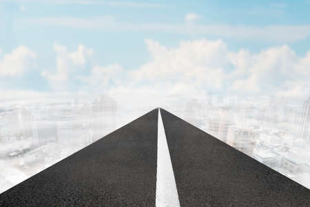 Asphalt road of white line in the sky white clouds cityscapes background.