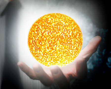 Big data concept. Male hand holding self-illuminated yellow ball of huge amount 3d letters and numbers with white light. Banco de Imagens