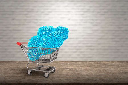 Big data and cloud computing concept. Shopping cart with cloud of blue letters and numbers on wooden table and blur bricks wall background, side view.