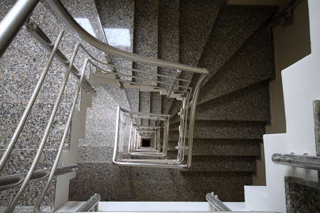 Looking down at spiral staircase in a building. Interior design