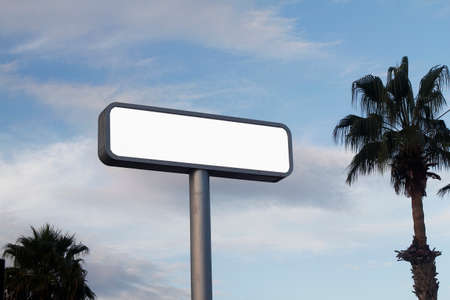 blank road sign on blue sky
