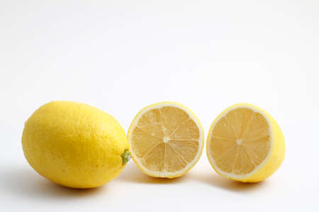 Ripe whole yellow lemon citrus fruit with lemon slice isolated on white background with clipping path. Full depth of field. 版權商用圖片