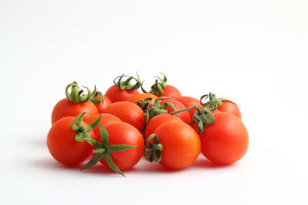 Cherry tomatoes isolated on a white background. Close-up. Copy space.