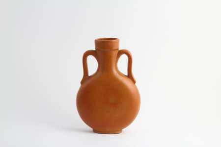 clay brown jug isolated on a white background. vintage empty jug front view. vintage capacity 版權商用圖片