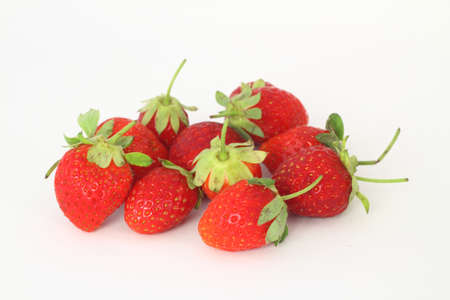 Red fresh strawberries on a white background. Green leaves of strawberries. Stok Fotoğraf