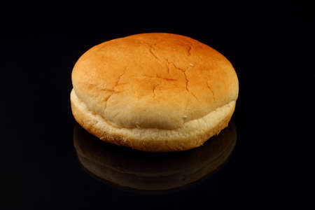 Yellow burger bread isolated on black background