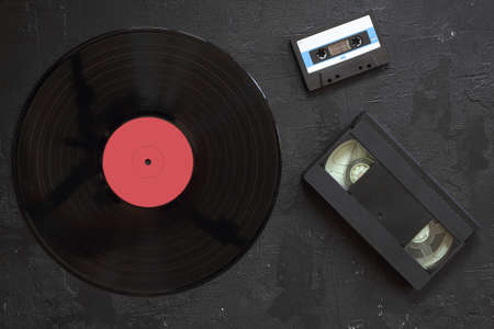 Vinyl record, audio and video cassettes top view